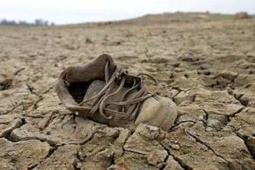 In this photo taken Tuesday Oct. 27, 2015, a shoe sits on the dry lake bed at Folsom Lake, in Folsom, Calif.