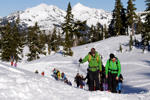 In this Jan. 11, 2016, photo Eric Gullickson, front left, an avalanche instructor with the Northwest Avalanche Center, leads teenagers on an avalanche awareness field trip at Mount Baker, Wash.