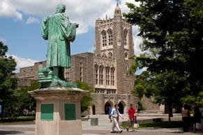 Pedestrians walk past a statue of former Princeton University president John Witherspoon near the Firestone Library on the school's campus in Princeton, New Jersey, U.S., on Monday, June 21, 2010.