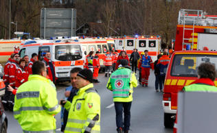 Rescue personnel wait in Bad Aibling, Germany, Tuesday, Feb. 9, 2016, after two ...