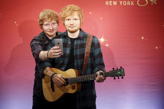 "Slide 1 of 23: <p>Musician Ed Sheeran takes a ""selfie"" with his wax figure at Madame Tussauds museum in the Manhattan borough of New York May 28, 2015. REUTERS/Shannon Stapleton TPX IMAGES OF THE DAY</p>"