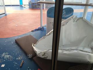 This image made available by Flavio Cadegiani shows damage to Royal Caribbean's ship Anthem of the Seas, Monday, Feb. 8, 2016. The ship ran into high winds and rough seas in the Atlantic Ocean on Sunday, forcing passengers into their cabins overnight. No injuries were reported and only minor damage to some public areas. The ship is turning around and sailing back to its home port in New Jersey. Flavio Cadegiani via AP
