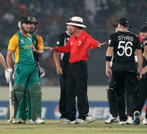Umpire Rod Tucker seperates Faf du Plessis (L) of South Africa and Scott Styris of New Zealand after an altercation during 2011 ICC World Cup Quarter-Final match.