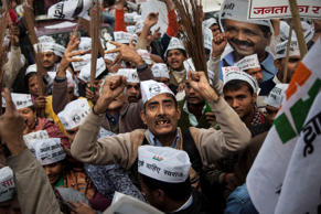 File: Aam Aadmi Party (AAP), or Common Man's Party supporters cheer for AAP chief Arvind Kerjiwal during a road show ahead of filing his nomination papers for the Delhi state elections in New Delhi, India, Tuesday, Jan. 20, 2015.