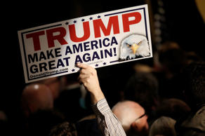 File: A supporter holds a placard at Republican U.S. presidential candidate Donald Trump's 2016 New Hampshire presidential primary election night rally in Manchester, New Hampshire, February 9, 2016. 2016.