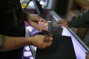 FILE- A customer shops for a handgun at the K&W Gunworks store on January 5, 2016 in Delray Beach, Florida.