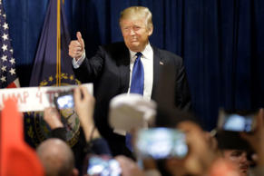 Republican presidential candidate, businessman Donald Trump greets supporters as...