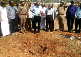 Indian authorities inspect the site of a suspected meteorite landing on February 7, 2016 in Vellore district in southern Tamil Nadu state in an impact that killed a bus driver and injured three others on February