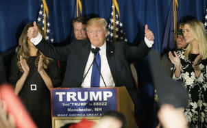Republican presidential candidate, businessman Donald Trump gives thumbs up to supporters during a primary night rally, Tuesday, Feb. 9, 2016, in Manchester, N.H.