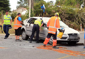 Emergency services recover a car that crashed after a police pursuit in Kumeu.