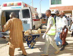 File: Rescue workers transport a victim of a suicide bomb attack at a refugee for treatment at a hospital, in Maiduguri, Nigeria, Wednesday, Feb. 10, 2016.