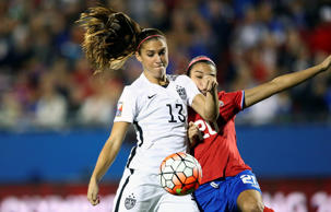 Alex Morgan #13 of USA scores a goal in the first minute of play against Wendy Acosta #20 of Costa Rica during the 2016 CONCACAF Women's Olympic Qualifying at Toyota Stadium on Wednesday in Frisco, Texas.