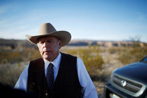 Rancher Cliven Bundy stands along the road near his ranch after speaking with me...