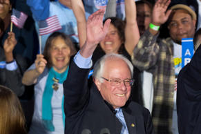 Democratic presidential candidate, Sen. Bernie Sanders, I-Vt., smiles and waves to the crowd at his primary night rally Tuesday, Feb. 9, 2016, in Concord, N.H.