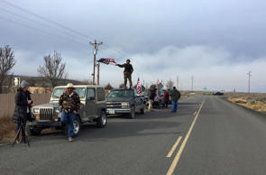 People wave American flags near the Malheur National Wildlife Refuge, Thursday, ...