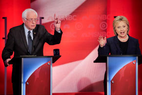 Democratic presidential candidate, Sen. Bernie Sanders, I-Vt, reacts to Democratic presidential candidate, Hillary Clinton's answer to a question during a Democratic presidential primary debate hosted by MSNBC at the University of New Hampshire Thursday, Feb. 4, 2016, in Durham, N.H.