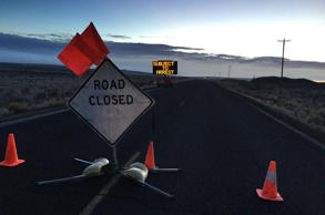 A closed Sod House Lane, about 4 miles outside of the Malheur National Wildlife Refuge in eastern Oregon, displays an electronic sign warning of arrest, Thursday morning, Feb. 11, 2016, near Burns, Ore. The last four armed occupiers of the national wildlife refuge in eastern Oregon said they would turn themselves in Thursday morning, after law officers surrounded them in a tense standoff.