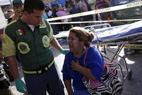 <p>An inmate's family member is being looked after by a Green Cross worker outside the Topo Chico prison in Monterrey.</p>