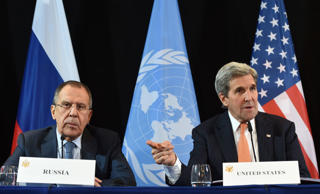 File: US Secretary of States John Kerry (R) gestures beside of Russian Foreign Minister Sergei Lavrov (L) during a news conference after the International Syria Support Group (ISSG) meeting in Munich, southern Germany, on February 12, 2016.