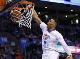 Oklahoma City Thunder guard Russell Westbrook (0) dunks in front of New Orleans ...
