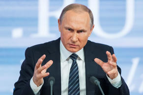 File: Russian President Vladimir Putin gestures during his annual news conference in Moscow, Russia, Thursday, Dec. 17, 2015.