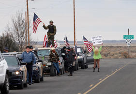 Authorities and demonstrators wait at the Narrows roadblock near the Malheur National Wildlife Refuge, Thursday, Feb. 11, 2016, near Burns, Ore. The last four occupiers of a national wildlife refuge in eastern Oregon surrendered Thursday.