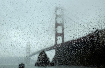 rain drops bead on a car window below the Golden Gate Bridge in Sausalito, Calif. Nearly a dozen days of rain have doused Northern California this month and more soakings are in store before February rolls around, while Southern California more or less has gotten short-shrift from the El Nino-backed storms, forecasters said Thursday, Jan. 21. The storms aren't yet enough to end California's four-year dry spell.