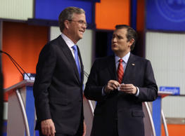 Ted Cruz, right, talks to Jeb Bush after a Republican presidential primary debate, Thursday, Jan. 28, 2016, in Des Moines, Iowa.