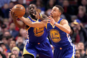Golden State Warriors guard Stephen Curry (30) and Draymond Green (23) go for a loose ball during the game against the Chicago Bulls, Jan. 20, 2016, in Chicago.