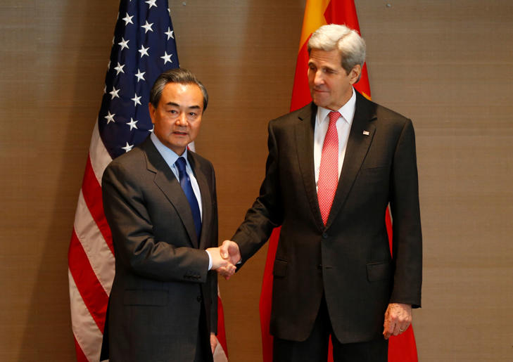 US Secretary of State John Kerry, right, shakes hands with China's Froreign, Minister Wang Yi, during a meeting in Munich, Germany prior to the start of the Munich Security Conference, Friday Feb. 12, 2016.