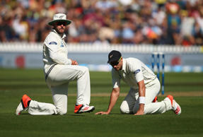 Mark Craig and Tim Southee of New Zealand look on after Mark Craig dropped Steve...