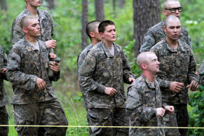 In this April 19, 2015 file photo, one of the 20 female soldiers, center, who is among the 400 students who qualified to start Ranger School, runs in place in between obstacles on the Darby Queen, one of the toughest obstacle courses in U.S. Army training, at Fort Benning, in Ga.