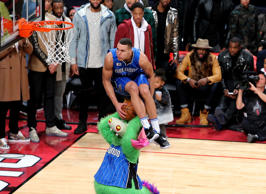 Aaron Gordon of the Orlando Magic dunks over Stuff the Orlando Magic mascot in t...
