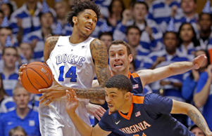 Duke's Brandon Ingram (14) holds onto the ball as Virginia's Darius Thompson (51) and Evan Nolte, rear, defend during the first half of an NCAA college basketball game in Durham, N.C., Saturday, Feb. 13, 2016.