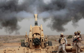 Saudi soldiers fire artillery toward three armed vehicles approaching the Saudi border with Yemen in Jazan, Saudi Arabia.