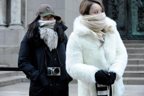 Street photographers brave the cold to photograph guests arriving to the Alexander Wang Fall 2016 show during Fashion Week, Saturday, Feb. 13, 2016, in New York.