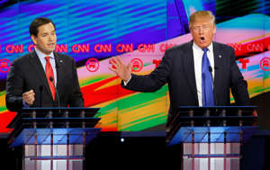 Republican U.S. presidential candidates Marco Rubio (L) and Donald Trump speak simultaneously at the debate sponsored by CNN for the 2016 Republican U.S. presidential candidates.