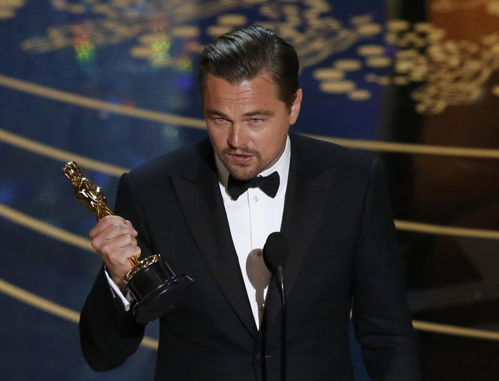 "<span style=""color:#666666;font-family:'Segoe UI', 'Segoe WP', Arial, sans-serif;font-size:13px;line-height:17.992px;""> Leonardo DiCaprio accepts the Oscar for Best Actor for the movie ""The Revenant"" at the 88th Academy Awards in Hollywood, California February 28, 2016. REUTERS/Mario Anzuoni</span>"