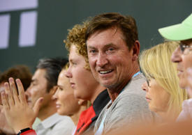 Mar 17, 2016; Indian Wells, CA, USA; Hall of Fame hockey player Wayne Gretzky watches the match between Milos Raonic (CAN) and Gael Monfils (FRA) in the BNP Paribas Open at the Indian Wells Tennis Garden. Raonic won 7-5, 6-3.