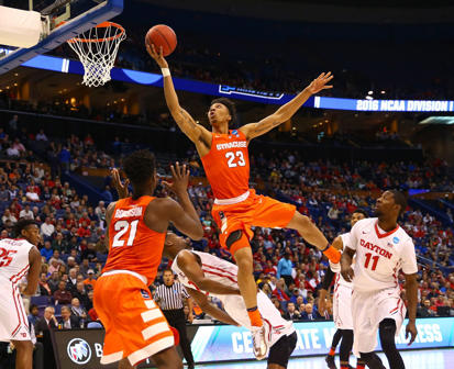 Malachi Richardson #23 of the Syracuse Orange drives to the basket and is fouled by Dyshawn Pierre #21 of the Dayton Flyers in the second half during the first round of the 2016 NCAA Men's Basketball Tournament at Scottrade Center on March 18, 2016 in St Louis, Missouri.