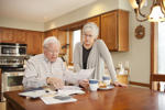 Mature couple looking at finances