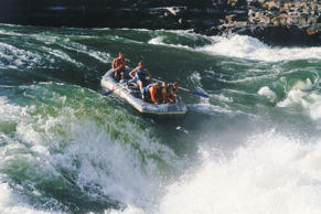 River rafting through white water rapids on Zambezi River.