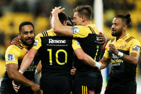 Ngani Laumape, Beauden Barrett, Jason Woodward and Matt Proctor of the Hurricanes celebrate Barrett's try during the round five Super Rugby match between the Hurricanes and the Kings at Westpac Stadium on March 25, 2016 in Wellington, New Zealand