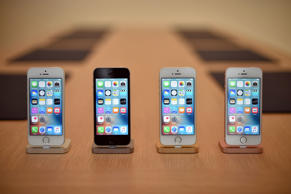 A set of iPhone SE handsets are seen on display during a media event at Apple headquarters in Cupertino, California on March 21, 2016.