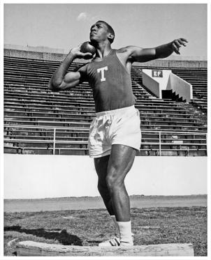 Slide 3 of 19: Bill Cosby during his years at Temple University, seen here throwing a shot-put, Philadelphia, PA, 1962.