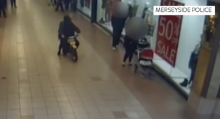 Man rides motorbike in shops