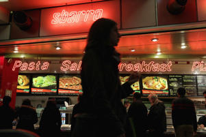 CHICAGO - APRIL 04:  Customers order lunch at a Sbarro restaurant on April 4, 2011 in Chicago, Illinois. The restaurant chain which has more than 1,000 locations in more than 40 countries, said today it is filing for Chapter 11 bankruptcy.  (Photo by Scott Olson/Getty Images)