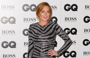 FILE- In this Sept. 2, 2012 file photo, Lindsay Lohan arrives for the GQ Men Of The Year Awards 2014 at a central London venue, London.