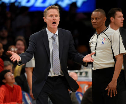 Golden State Warriors head coach Steve Kerr yells to the officials to question a call during the second half of the game against the Los Angeles Lakers in Los Angeles, Sunday. The Warriors lost 95-112.