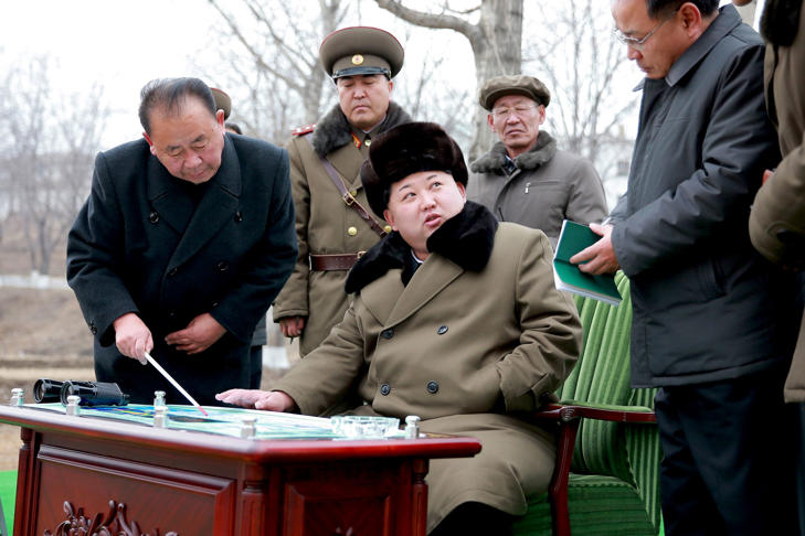 North Korean leader Kim Jong Un (seated) gives instruction during a simulated test of atmospheric re-entry of a ballistic missile at an unidentified location in this undated photo released on March 15, 2016 in Pyongyang, North Korea.